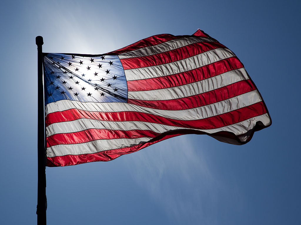 U.S. Flag backlit by the sun